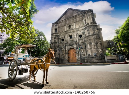 Horse Drawn Carriage parking in front of Malate church , Manila Philippines - stock photo