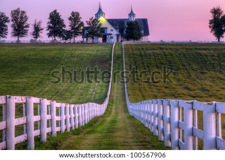 Horse farm at sunset - stock photo