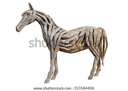 Horse made of scrap wood isolated on white with clipping path - stock photo