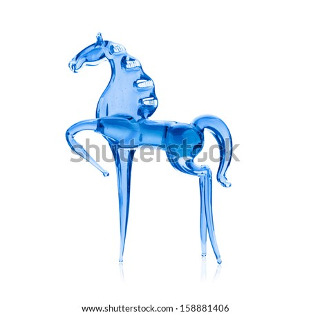 Horse out of the blue glass, isolated on white background - stock photo