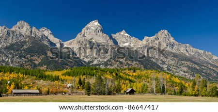 Horse ranch and the Teton Mountains in autumn, Grand Teton National Park, Wyoming, USA