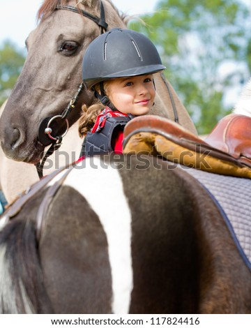 Horse riding - portrait of lovely equestrian - stock photo