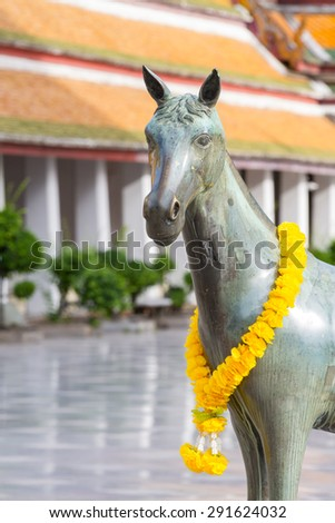 horse sculpture at Wat Suthat, a royal temple of first grade, one of ten such temples in Bangkok - stock photo