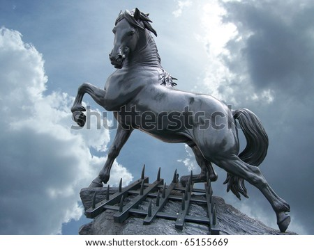 horse statue on the sky with clouds - stock photo