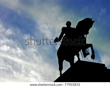 Horse statue silhouette memorial over a blue sky background