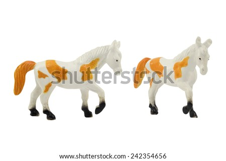 Horse toy. Isolated white horse toy with orange tail and spots different angles photo.
