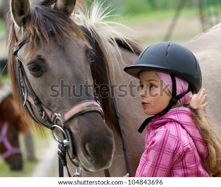 Horse whispers - Horse and lovely girl - best friends - stock photo
