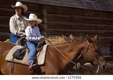 Horseback Mother and Daughter - stock photo