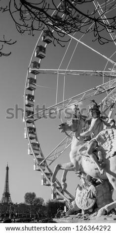 Horseman statue. Ferris wheel and Eiffel tower at background. Paris. - stock photo
