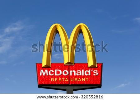 Horsens, Denmark - September 3, 2015: McDonald's logo. McDonald's is the world's largest chain of hamburger fast food restaurants. - stock photo
