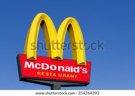 Horsens, Denmark - september 30, 2015: McDonald's logo on a pole. McDonald's is the world's largest chain of hamburger fast food restaurants - stock photo