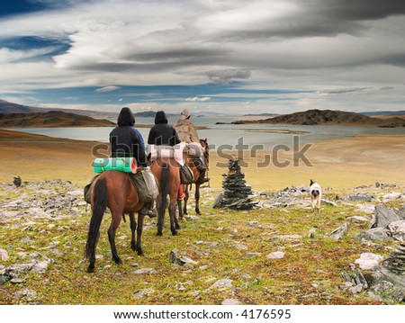 Horseriders in mongolian wilderness - stock photo