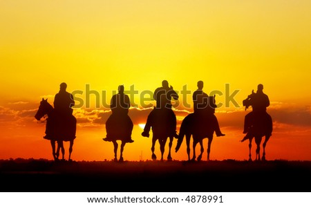 horseriders - vector version also available - stock photo