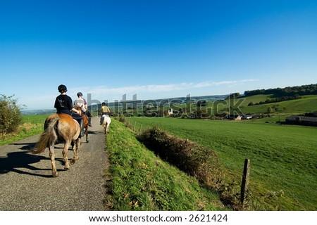Horseriding in beautiful scenery - stock photo