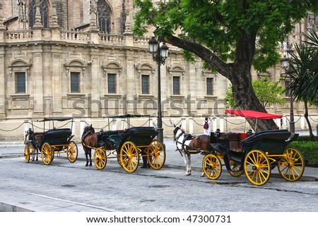 Horses and carts outside of Seville cathedral, Seville, Spain - stock photo