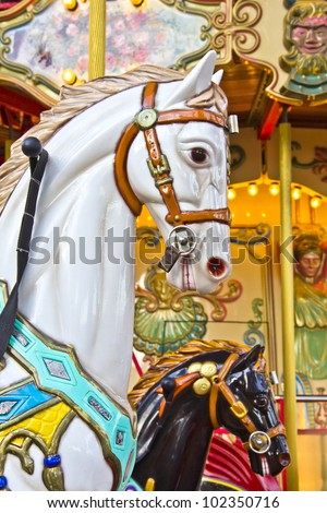 Horses on a Merry Go Round - stock photo