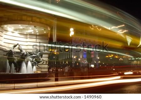 Horses statue and street traffic at piccadilly circus by night - stock photo