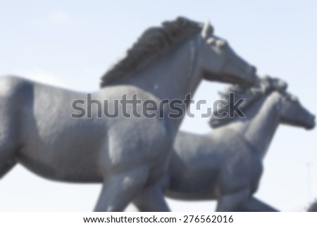 horses statue ,blurred background - stock photo