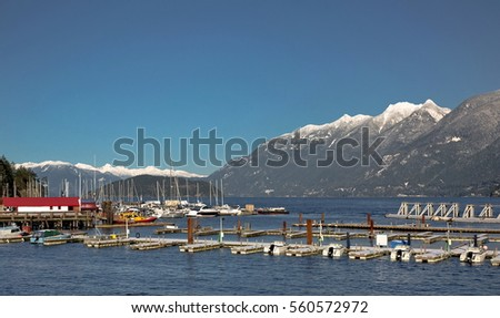 Horseshoe Bay West Vancouver Marina, parking of boats and yachts on the background of snow-covered mountains ridge