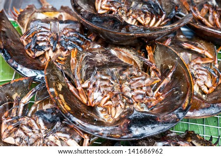Horseshoe crab burned for cooking. - stock photo