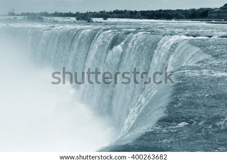 Horseshoe Falls closeup in the day with mist in black and white