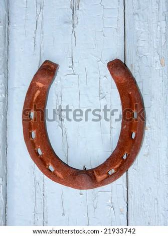 Horseshoe on the old door - stock photo