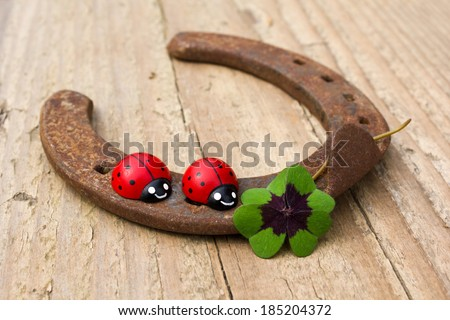 horseshoe with ladybugs and lucky clover/luck/horseshoe - stock photo