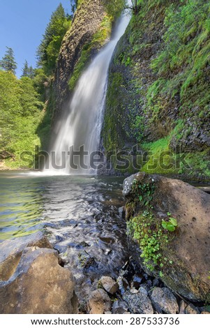 Horsetail Falls in Columbia River Gorge Oregon on a Sunny Day with Clear Blue Sky - stock photo