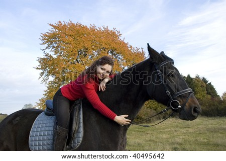 Horsewoman lay down on the withers of the horse.