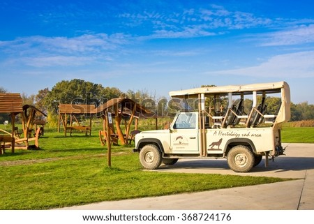 HORTOBAGY, HUNGARY - OCTOBER 31, 2015: Safari car in Hortobagy National Park, Hungary. It is Unesco World Heritage site since 1999. The Whole area is Natura 2000 protection area as well