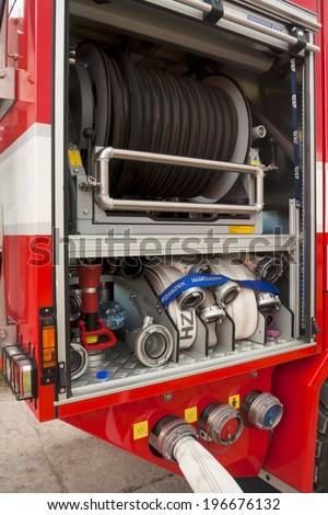 Hose area in fire fighting vehicle - stock photo
