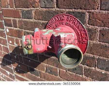 Hose connection for fire department on brick wall - stock photo