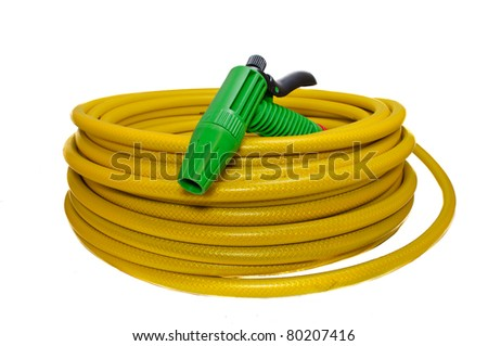 Hose for watering the garden with the spray. Isolated on white background - stock photo