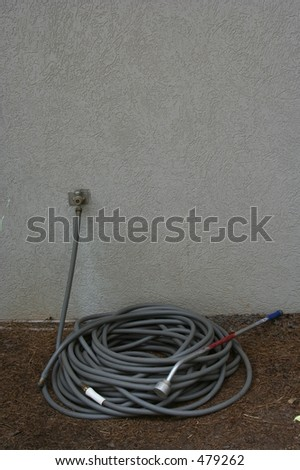 Hose next to wall (ample Text Space) - stock photo