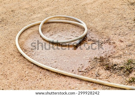 Hose on the dry ground.The drought situation in the country of thailand.