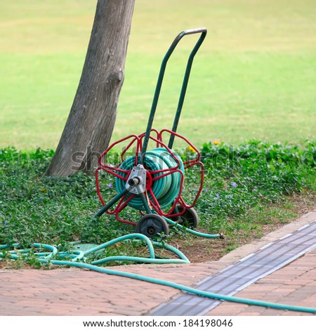 hose pipe on wheeled reel   - stock photo