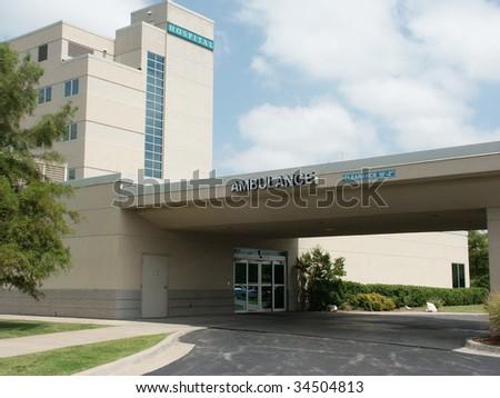 Hospital ambulance enterance. Name of the hospital removed - stock photo