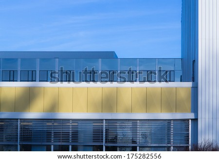 hospital architectural detail with yellow asbestos plates. - stock photo