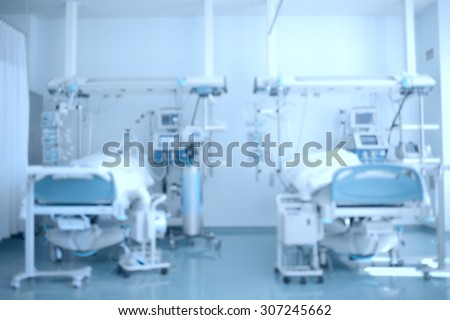 Hospital background. Defocused image of a hospital ward (ICU) with patients on beds - stock photo