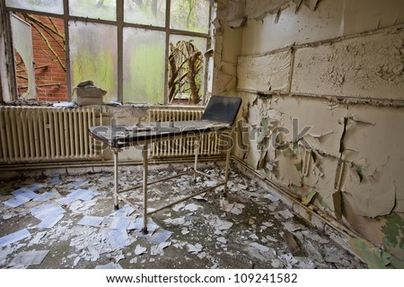 hospital bed in an abandoned hospital - stock photo