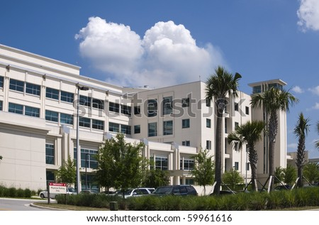 Hospital building showing Physician parking with blue sky - stock photo
