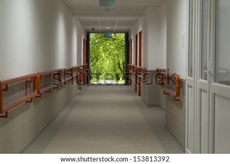 hospital corridor with view - stock photo