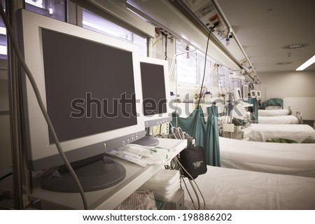 Hospital emergency room with equipment and beds. Horizontal