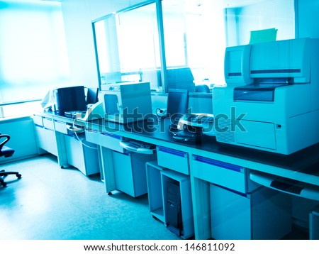 hospital lab with computer and chemistry equipment. - stock photo