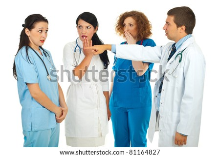 Hospital manager accusing  doctor woman and pointing and her colleagues doctors women being surprised and scared isolated on white background