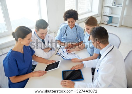hospital, medical education, health care, people and medicine concept - group of happy doctors with tablet pc computers meeting at medical office - stock photo