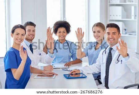 hospital, profession, people and medicine concept - group of happy doctors meeting at medical office - stock photo