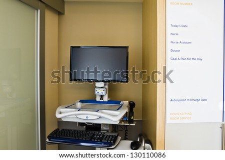 Hospital Room Medical Records Computer and Information Board - stock photo