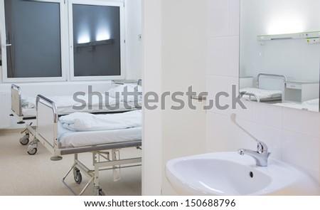 hospital room with bathroom - stock photo