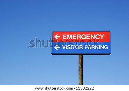 Hospital sign directs visitors - stock photo